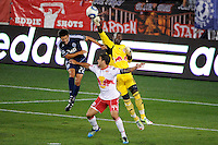 New York Red Bulls goalkeeper Bouna Coundoul (18) punches a ball away from Shea Salinas (22) of the Vancouver Whitecaps during a Major League Soccer (MLS) match at Red Bull Arena in Harrison, NJ, on September 10, 2011.