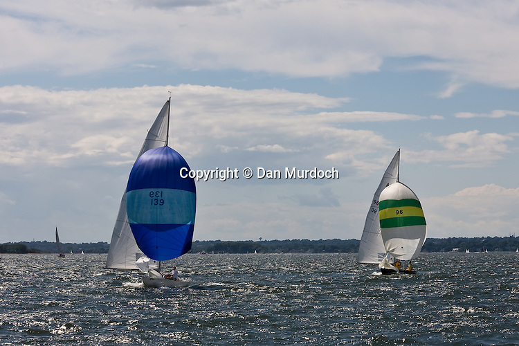 two racking sailboats with spinnakers set