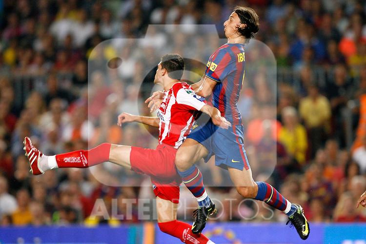 FC Barcelona's Zlatan Ibrahimovic (r) and Sporting de Gijon's Alberto Tomas Botia during La Liga match.August 31 2009. (ALTERPHOTOS/Acero).