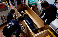 BOGOTA, COLOMBIA - MAY 14: Workers make a demonstration of a hospital bed which in case to be needed can be used as a coffin in Bogota, May 14, 2020. The bed was designed by a Colombian company for COVID-19 patients amid the new coronavirus pandemic that infected 12.930 people and claimed 509 lives in the country. (Photo by Leonardo Munoz/VIEWpress)