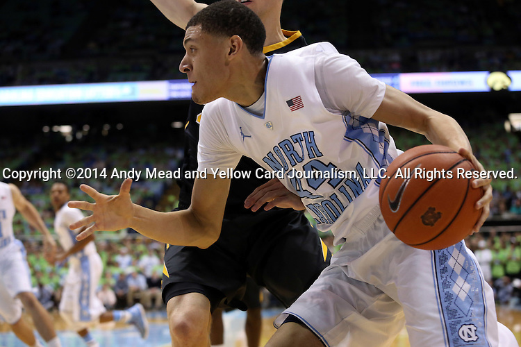 03 December 2014: North Carolina's Justin Jackson. The University of North Carolina Tar Heels played the University of Iowa Hawkeyes in an NCAA Division I Men's basketball game at the Dean E. Smith Center in Chapel Hill, North Carolina. Iowa won the game 60-55.
