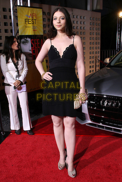 """MICHELLE TRACHTENBERG .AFI  Film Festival Closing Night """"Defiance"""" Premiere held at The Archlight Theatre, Hollywood, California, USA, 9 November 2008..full length black dress hand on hip gold clutch bag beige open toe shoes .CAP/ADM/KB.©Kevan Brooks/Admedia/Capital PIctures"""