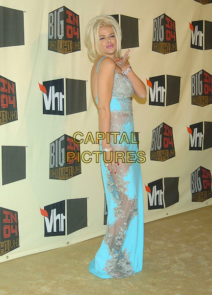 ANNA NICOLE SMITH.VH1 Big in '04 held at the Shrine Auditorium, Los Angeles, California, 01 December 2004..full length blue turquoise dress silversheer see through.**UK SALES ONLY**.Ref: ADM.www.capitalpictures.com.sales@capitalpictures.com.©V.Summers/AdMedia/Capital Pictures .