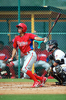 GCL Phillies Johnathan Knight #25 hits his first professional home run during a Gulf Coast League game against the GCL Pirates at Pirate City on July 18, 2012 in Bradenton, Florida.  GCL Pirates defeated the GCL Phillies 6-3.  (Mike Janes/Four Seam Images)