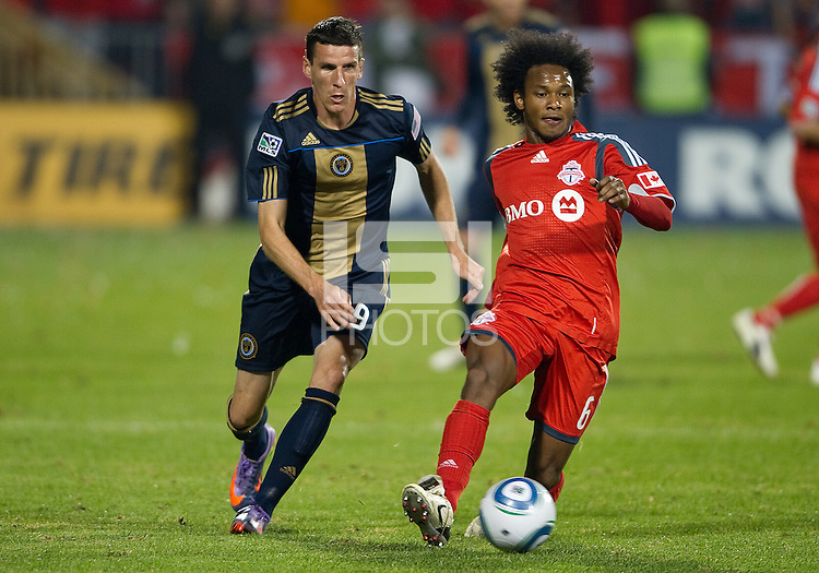 15 April 2010: Philadelphia Union forward Sebastien Le Toux #9 and Toronto FC midfielder Julian de Guzman #6 in action during a game between the Philadelphia Union and Toronto FC at BMO Field in Toronto..Toronto FC won 2-1..Photo by Nick Turchiaro/isiphotos.com.