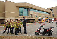 NWA Democrat-Gazette/ANDY SHUPE<br /> Fayetteville firefighters gather Wednesday, Nov. 25, 2015, outside Kimpel Hall on the University of Arkansas campus during a hazardous-materials and confined-space extrication drill in Fayetteville. The quarterly training exercise involved Fayetteville, Springdale and Rogers fire departments as well as Central EMS and the University of Arkansas Police Department. Personnel removed an injured patient through a tunnel system during a mock campus shooting event.