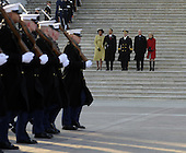 Washington, DC - January 20, 2009 -- United States President Barack Obama, his wife Michelle (L), Vice President Joseph Biden (2-R) and his wife Jill (R) are escorted by Major General Richard Rowe as they review the troops from the steps of the U.S Capitol Building after Obama was sworn in as the 44th President of the United States during the 56th Presidential Inauguration ceremony in Washington, D.C., USA 20 January 2009..Credit: Tannen Maury - Pool via CNP
