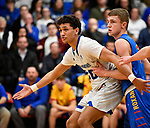 Alton Marquette guard Brett Terry (left) calls for a pass as he is guarded by Roxana forward Braeden Wells. Alton Marquette played Roxana in the Class 2A Roxana boys basketball regional final at Roxana High School in Roxana, Illinois on Friday February 28, 2020. <br /> Tim Vizer/Special to STLhighschoolsports.com