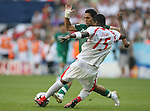 14 June 2006: Radhi Jaidi (TUN) (15) is defended by Yaser Al Kahtani (KSA) (behind). Tunisia and Saudi Arabia tied 2-2 at the Allianz Arena in Munich, Germany in match 16, a Group H first round game, of the 2006 FIFA World Cup.