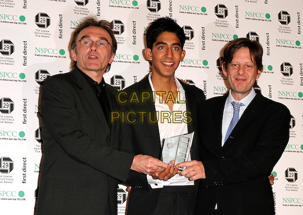 DANNY BOYLE, DEV PATEL & SIMON BEAUFOY .Press room - London Film Critics' Circle Awards, Grosvenor House Hotel, London, England, February 4th 2009..half length director actor writer award winners winner .CAP/CAN.©Can Nguyen/Capital Pictures