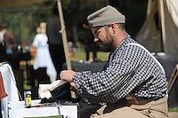 NWA Democrat-Gazette/ANDY SHUPE<br /> Jason Willis of Cotter sews a Civil War-era hat Saturday, Sept. 26, 2015, during a re-enactment of the Civil War Battle of Pea Ridge in Pea Ridge. Visit nwadg.com/photos to see more photos from the weekend.