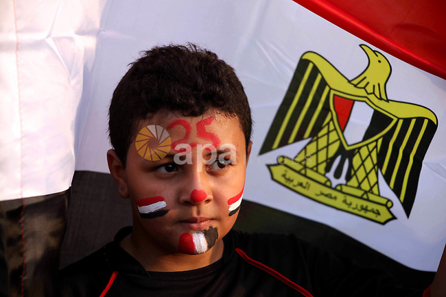 An Egyptian child draws national flag on face during a demonstration  against Egyptian presidential candidate Ahmed Shafiq in Tahrir Square decrying the result of the first round of voting in the Egyptian presidential election in Cairo, Egypt, Friday, June 1, 2012. Several hundred protesters rallied Friday in Cairo's Tahrir Square, the birthplace of the Egyptian uprising. Photo by Ashraf Amra
