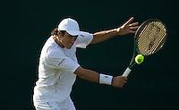 Martin Vassallo Arguello (ARG) against  Stanislas Wawrinka (SUI) (19)  in the second round of the gentlemen's singles. Wawrinka beat Arguello 6-3 6-2 6-2..Tennis - Wimbledon - Day 4 - Thur 25th June 2009 - All England Lawn Tennis Club  - Wimbledon - London - United Kingdom..Frey Images, Barry House, 20-22 Worple Road, London, SW19 4DH.Tel - +44 20 8947 0100.Cell - +44 7843 383 012