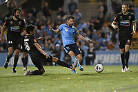 1st November 2019; Leichhardt Oval, Sydney, New South Wales, Australia; A League Football, Sydney Football Club versus Newcastle Jets; Kosta Barbarouses of Sydneys shoots to score his goal to make it 4-1 as John Koutroumbis of Newcastle Jets slides in too late to block - Editorial Use