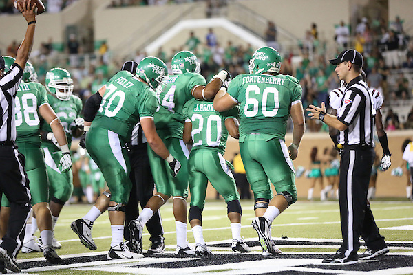 Denton, TX - SEPTEMBER 8: Jeremy Brown #20 of the North Texas Mean Green celebrates a touchdown against the Texas Southern Tigers at Apogee Stadium in Denton on September 8, 2012 in Denton, Texas. NT won 34-7. Photo by: Rick Yeatts