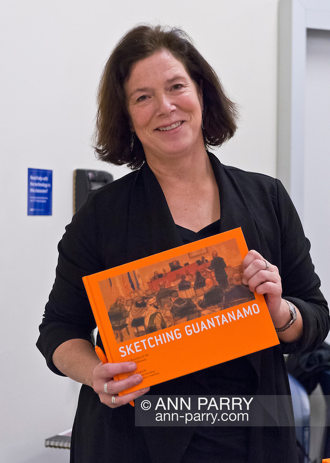 Hempstead, New York, U.S. 12th November 2013.  JANET HAMLIN, a courtroom artist covering the military tribunals at Guantanamo Bay since 2006, shows her drawings and discusses her work at Hofstra University. Much of the time she was the only journalist providing a visual record of the events at the United States naval base in Cuba, and she's holding her new book 'Sketching Guantanomo' a collection of her images.