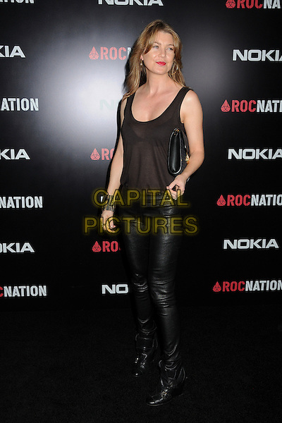 Ellen Pompeo.Roc Nation Pre-Grammy Brunch held at Soho House, West Hollywood, California, USA, 11th February 2012..full length sheer black vest bra cuff gold clutch bag leather pants trousers .CAP/ADM/BP.©Byron Purvis/AdMedia/Capital Pictures.