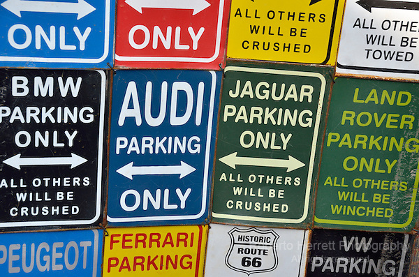 Exclusive parking signs for various different car models.