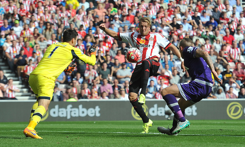 Sunderland's Ola Toivonen has a shot on goal<br /> <br /> Photographer Dave Howarth/CameraSport<br /> <br /> Football - Barclays Premiership - Sunderland v Tottenham Hotspur - Sunday 13th September 2015 - Stadium of Light - Sunderland<br /> <br /> &copy; CameraSport - 43 Linden Ave. Countesthorpe. Leicester. England. LE8 5PG - Tel: +44 (0) 116 277 4147 - admin@camerasport.com - www.camerasport.com