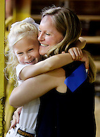 NWA Democrat-Gazette/DAVID GOTTSCHALK  Mallory Noggle, of West Fork, gives her daughter Macie, 6, a hug after placing first in the novice showmanship division with a Jersey Heffer Tuesday, September 1, 2015 in the show barn on the Washington County Fair Grounds in Fayetteville. The Washington County Fair runs through September 5.