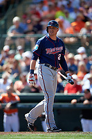 Minnesota Twins designated hitter Ryan Sweeney (26) walks back to the dugout during a Spring Training game against the Baltimore Orioles on March 7, 2016 at Ed Smith Stadium in Sarasota, Florida.  Minnesota defeated Baltimore 3-0.  (Mike Janes/Four Seam Images)
