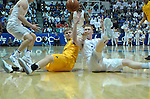 February 4, 2017:  Wyoming guard, Jason McManamen #23, and Falcon center, Frank Toohey #33, struggle for a loose ball during the NCAA basketball game between the Wyoming Cowboys and the Air Force Academy Falcons, Clune Arena, U.S. Air Force Academy, Colorado Springs, Colorado.  Wyoming defeats Air Force 83-74.