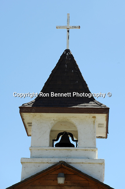 White church steeple with bell tower and cross California,