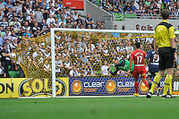 MELBOURNE, AUSTRALIA - JANUARY 09: Michael Petkovic of the Victory fails to save a goal from a free kick by Sergio van Dijk of United during the round 22 A-League match between the Melbourne Victory and Adelaide United at AAMI Park on January 9, 2011 in Melbourne, Australia. (Photo by Sydney Low / Asterisk Images)