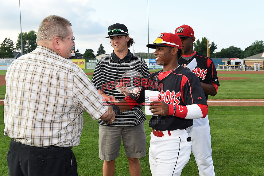 Batavia Muckdogs second baseman Mason Davis (7) receives the Most Popular Player Award from Booster Club President Hal Mitchell before a game against the Mahoning Valley Scrappers as Michael Mader and Alex Carreras look on on August 22, 2014 at Dwyer Stadium in Batavia, New York.  Mahoning Valley defeated Batavia 2-1.  (Mike Janes/Four Seam Images)
