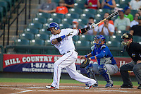 Round Rock Express designated hitter Manny Ramirez (99) follows through on his swing against the Iowa Cubs in the Pacific Coast League baseball game on July 21, 2013 at the Dell Diamond in Round Rock, Texas. Round Rock defeated Iowa 3-0. (Andrew Woolley/Four Seam Images)