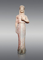 Parian marble Ancient Greek Archaic statue of a kore by Ariston of Paros, found in Merenda, Attica, Circa 540-530 BC, Athens National Archaeological Museum. Cat no 4889. Against grey.<br /> <br /> This funerary statue was found in the same pit as Phrasikleia cat no 4890. The expression on the face and the rendering of the garment that follows the curves of the body underneath are remarkable. The chiton retains in many places its painted decoration with rosettes, swastikas, stars and meanders. This Kore is an extraordinary statue and is one of the most inportant of the Archaic Period. Mad by sculptor Ariston from Paros
