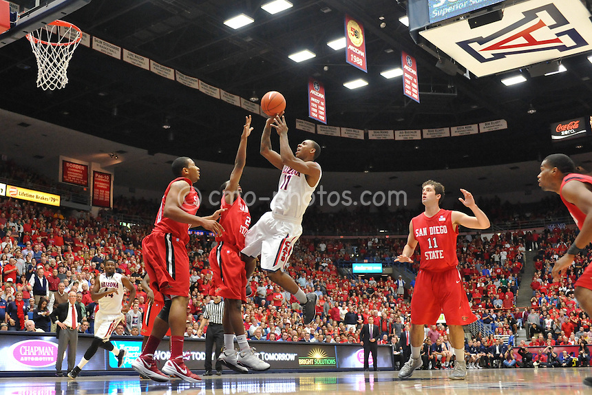 Nov 23, 2011; Tucson, AZ, USA; Arizona Wildcats guard Josiah Turner (11) shoots the ball over the out stretched arm of San Diego State Aztecs guard Xavier Thames (2) in the first half of a game at the McKale Center.  The Aztecs won 61-57.  Mandatory Credit: Chris Morrison-US PRESSWIRE