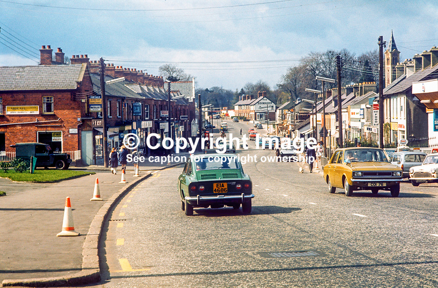 Main street, Dunmurry Village, Belfast, N Ireland, UK, May, 1972, 197205000276<br /> <br /> Copyright Image from Victor Patterson, 54 Dorchester Park, Belfast, UK, BT9 6RJ<br /> <br /> t1: +44 28 9066 1296<br /> t2: +44 28 9002 2446<br /> m: +44 7802 353836<br /> <br /> e1: victorpatterson@me.com<br /> e2: victorpatterson@gmail.com<br /> <br /> www.victorpatterson.com<br /> <br /> IMPORTANT: Please see my Terms and Conditions of Use at www.victorpatterson.com