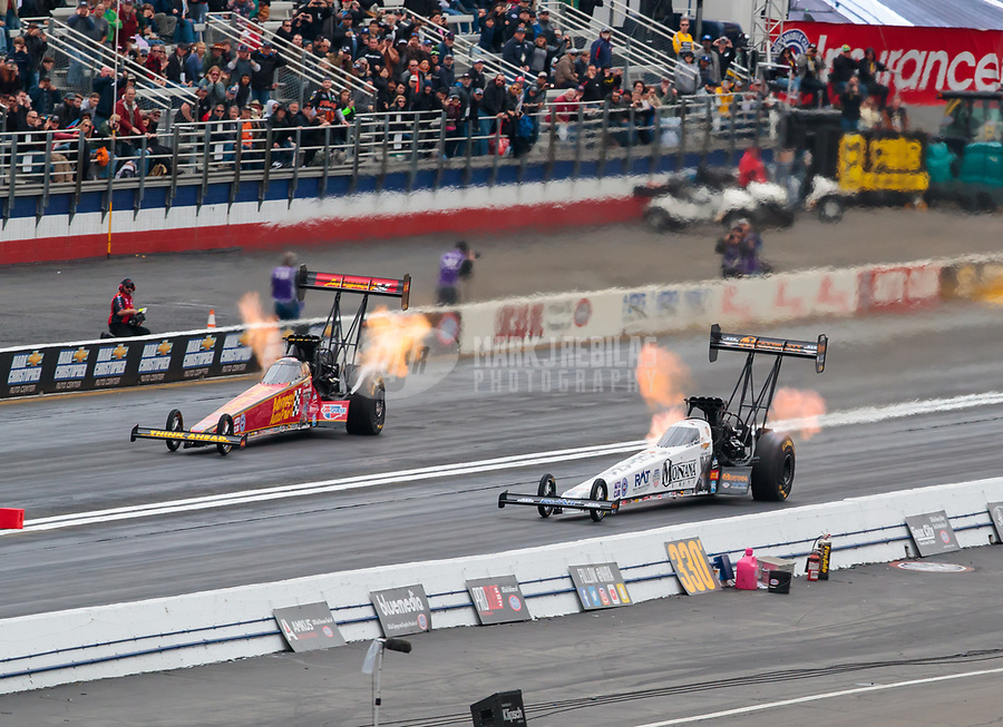 Feb 10, 2019; Pomona, CA, USA; NHRA top fuel driver Austin Prock (right) defeats teammate Brittany Force for the first round win of his NHRA career during the Winternationals at Auto Club Raceway at Pomona. Mandatory Credit: Mark J. Rebilas-USA TODAY Sports
