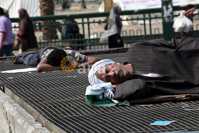 Egyptians sleep during a sit-in at Tahrir Square, after a court sentenced deposed president Hosni Mubarak to life in prison, in Cairo June 4, 2012. Thousands of Egyptians have taken to the streets in protest at the verdict, some wanting the death sentence for Mubarak, others fearing weaknesses in the prosecution case could enable him to appeal successfully against his life sentence. Photo by Ashraf Amra