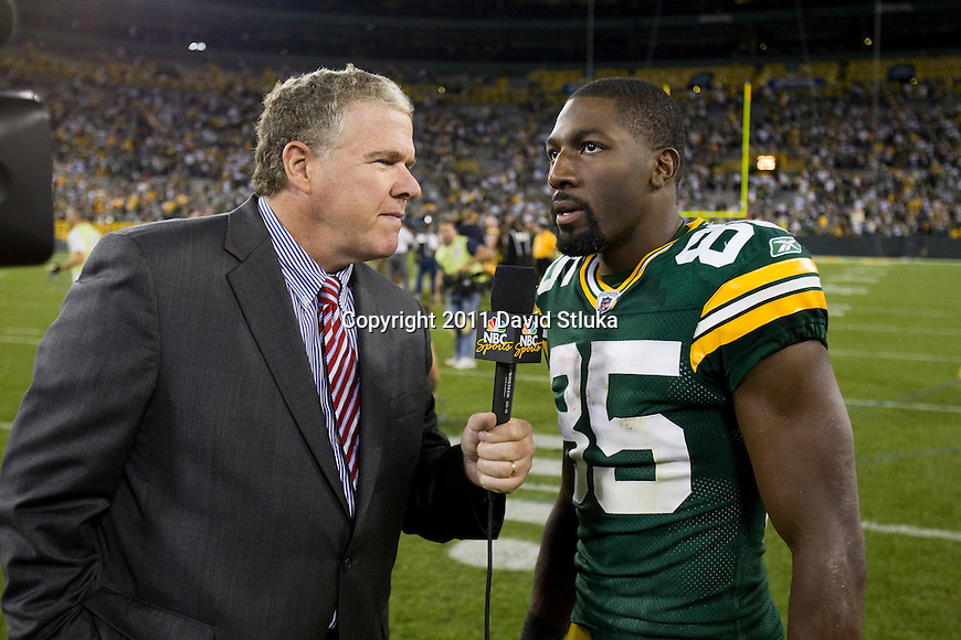 Green Bay Packers wide receiver Greg Jennings (85) is interviewed by NBC Sports reporter Peter King during a Week 1 NFL football game against the New Orleans Saints on September 9, 2011 in Green Bay, Wisconsin. The Packers won 42-34. (AP Photo/David Stluka)