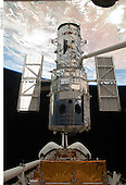 In Earth Orbit - May 19, 2009 -- The Space Shuttle Atlantis' remote manipulator system arm lifts the Hubble Space Telescope from the cargo bay and is moments away from releasing the orbital observatory to start it on its way back home to observe the universe..Credit: NASA via CNP