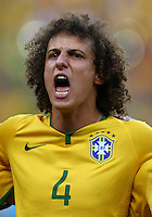 David Luiz of Brazil sings his national anthem