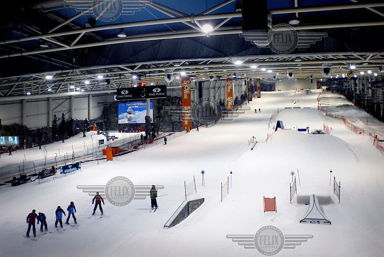 A handful of people use the slopes at Snow Zone, an artificial sking centre outside of the town of Arroyomolinos near Madrid.