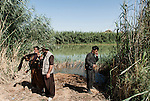 30/09/14  Iraq -- Daquq, Iraq -- Peshmerga fighters at the frontline on Rokhana river in Wahda village, Daquq.