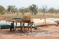 MALI, Kayes, Sadiola, water storing and filling station, water is stored in large plastic film bags for sale to small scale goldminers / Wassertankstelle, Wasserspeicher in grossen Säcken, Verkauf an Goldwäscher