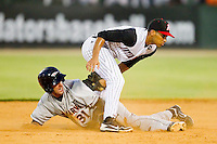 Michael Rooney #31 of the Delmarva Shorebirds is tagged out by Marcus Semien #6 of the Kannapolis Intimidators as he tries to steal second base at Fieldcrest Cannon Stadium on August 6, 2011 in Kannapolis, North Carolina.  The Intimidators defeated the Shorebirds 14-6.   (Brian Westerholt / Four Seam Images)