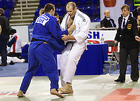 27 MAR 2011 - SHEFFIELD, GBR - Christopher Sherrington (white) v Matthew Clempner (blue) - men's over 100kg category - English Senior Open Judo Championships (PHOTO (C) NIGEL FARROW)