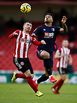 Joshua King of Bournemouth and John Fleck of Sheffield Utd during the Premier League match at Bramall Lane, Sheffield. Picture date: 9th February 2020. Picture credit should read: Simon Bellis/Sportimage
