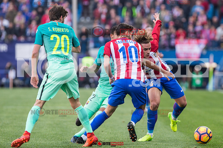 Yannick Ferreira Carrasco, Antoine Griezmann of Atletico de Madrid competes for the ball with Sergi Roberto and Rafinha Alcantara of Futbol Club Barcelona during the match of Spanish La Liga between Atletico de Madrid and Futbol Club Barcelona at Vicente Calderon Stadium in Madrid, Spain. February 26, 2017. (ALTERPHOTOS) /NortEPhoto.com