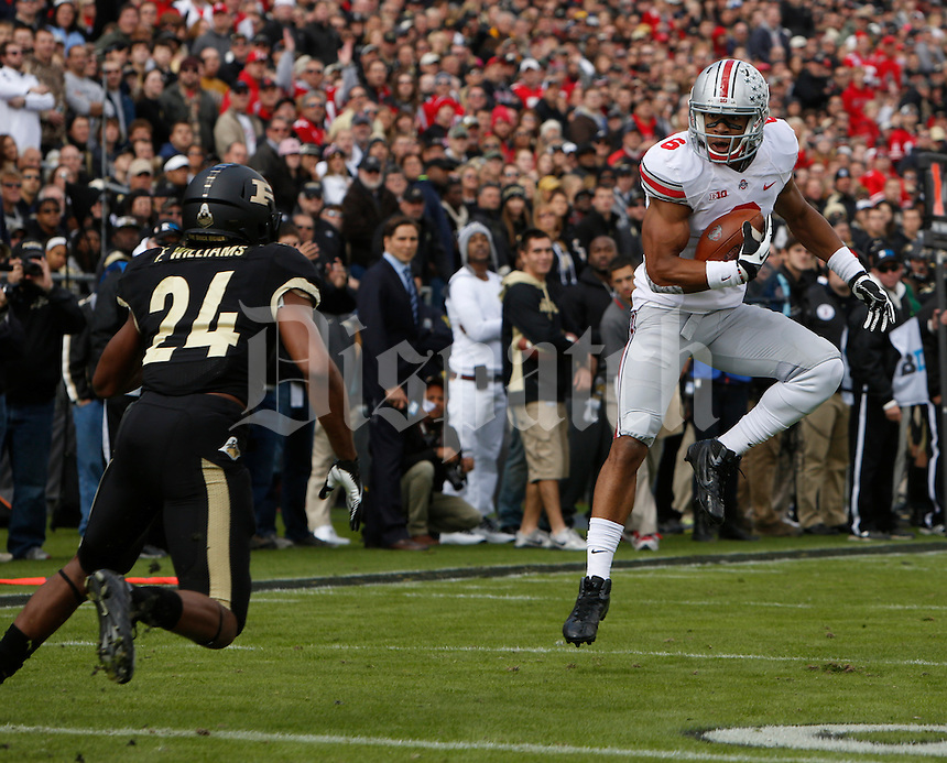 Ohio State Buckeyes wide receiver Evan Spencer (6) catches a pass while defended by Purdue Boilermakers defensive back Frankie Williams (24) during Saturday's NCAA Division I football game at Ross-Ade Stadium in West Lafayette, In. on November 2, 2013. (Barbara J. Perenic/The Columbus Dispatch)