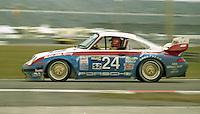 The #24 Porsche 911 of Joe Cogbill, Ron Finger, John Rutherford IV, Monte Shelton, and Charles Slater races to a 14th place finish inthe 24 Hours of Daytona, IMSA race, Daytona International Speedway, Daytona Beach , FL, February 4, 1996.  (Photo by Brian Cleary/www.bcpix.com)