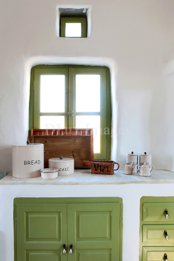 traditional cycladic kitchen with olive green cabinets
