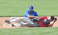 RICK PECK/SPECIAL TO MCDONALD COUNTY PRESS McDonald County's Kameron Hopkins gets tagged out at second base during the McDonald County 18U baseball team's 6-5 loss on June 2 to Carthage in the Carl Junction 18U Baseball Tournament at Carl Junction High School.