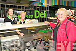 Collin's New Gala Store :  Michelle Egan & Mary Bridgeman  serving up hot food from the Deli counter to Breda Collins at Collin's new store in Tarbert.